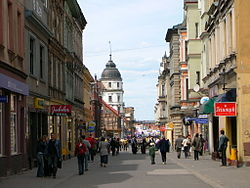 Królowej Jadwigi Street filled with historic architecture leading to the market square
