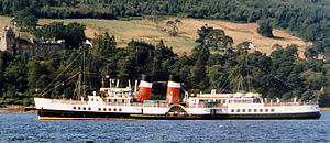 The Paddle Steamer Waverley lies in Brodick Bay in front of Brodick Castle, waiting for the car ferry to leave before returning to the pier.