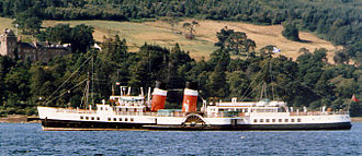 Islands of the Clyde - The PS Waverley lying in Brodick Bay in front of Brodick Castle. Paddle steamers like this were formerly extremely common on the Clyde.