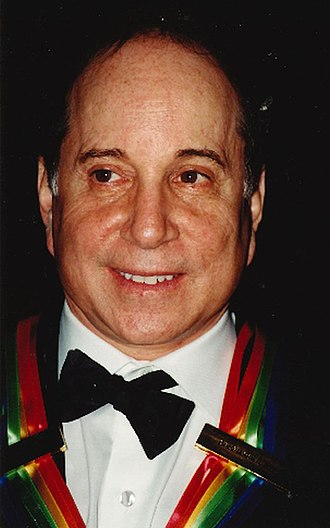 Paul Simon - Simon wearing the Kennedy Center Honors ribbon