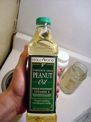 Peanut oil - A bottle of peanut oil, with Vitamin E added as a preservative