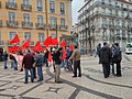 People with red flags (8640589237).jpg