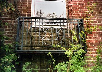 Phi Tau - The stylized Greek letters ΦΣΚ appear in a wrought iron railing on the southwest corner of the 1928 residence, photographed in 1995.