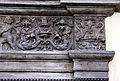 Piazza cattaneo, portale in pietra nera con medaglioni di imperatori e fregio con girali, delfini, e putti reggistemma, xvi secolo 05.jpg