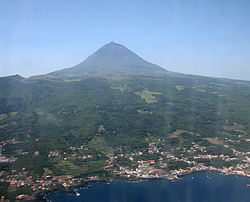 The island of Pico, as seen from the north-central coast, showing the town of São Roque in the foreground and Mount Pico in the background