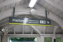 Platform sign at Bromborough railway station (28652865475).jpg