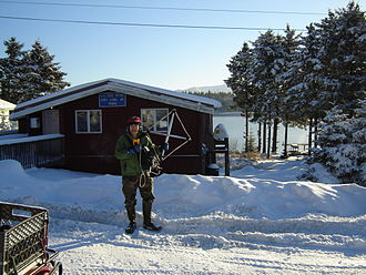Port Lions, Alaska - A radio scientist from Stanford University at the Port Lions post office.
