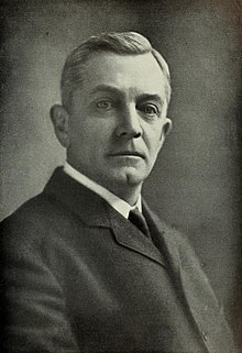A black and white picture of James H. Stout