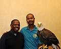 Posing for picture with Bald Eagle. (10595265645).jpg