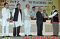 Pranab Mukherjee presenting the National Award for Teachers-2012 to Shri Girin Tamuly, Arunachal Pradesh, on the occasion of the 'Teachers Day', in New Delhi. The Union Minister for Human Resource Development.jpg