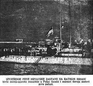 Croatian Navy - First Croatian flag ever hoisted on a naval ship, Pula, October 31st, 1918, with the crews saluting the flag.