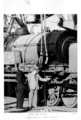Queensland State Archives 4270 Mr Rasey and Mr Whyte MsLA in front of a garatt locomotive 1950.png