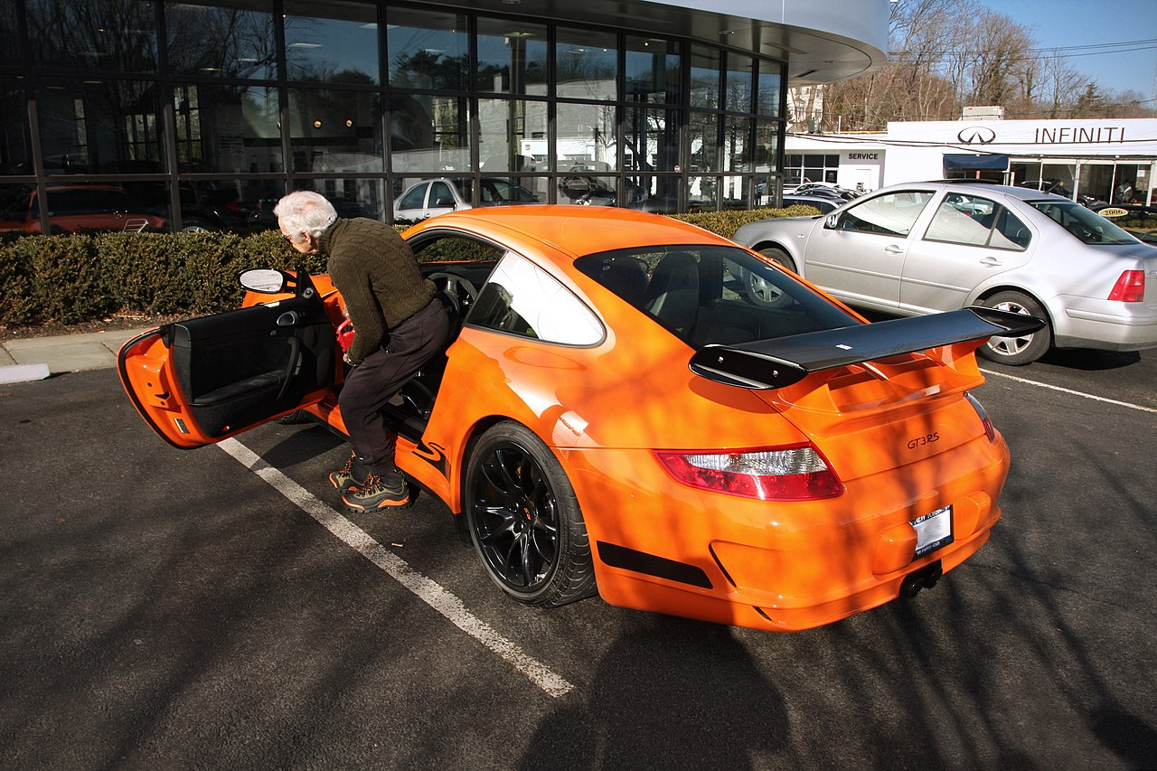 740f9d206b4 File:Ralph Lauren getting in his orange 997 GT3 RS.jpg - Wikimedia ...