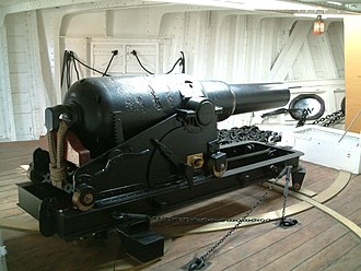Muzzle-loading rifle - A 6.3 inch 64-pounder rifled muzzle loader in the forecastle of HMS Gannet (1878)