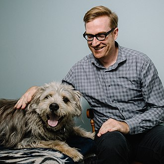 Ryan North - North with his dog, Noam Chompsky (left)