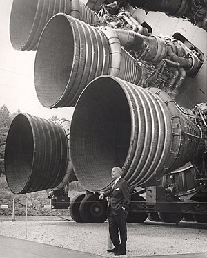 Werner von Braun stands by the five F-1 engines of the Saturn V launch vehicle