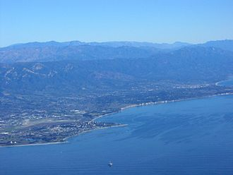 Santa Barbara County, California - South Coast of Santa Barbara County, view looking northeast, showing, from left to right, Isla Vista, Goleta, Hope Ranch, Santa Barbara. All the mountains except for the most distant in the right rear are in Santa Barbara County.