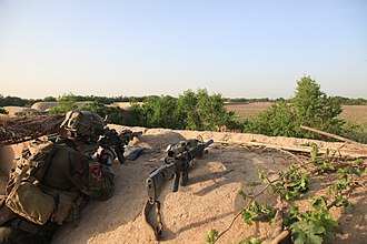 Marine Raider Regiment - A Marine Raider with 1st MSOB, assigned to Special Operations Task Force-West waits in ambush for insurgents during a joint patrol with Afghan Commandos in Helmand Province, 15 April 2012.