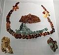 Sabini adriatici, ornamenti dalla tomba femminile 10 di case pecci (tortoreto), 810-700 ac ca., pettorale in bronzo e ambra.jpg