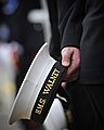 Sailor from HMS Walney Holding His Cap During the Ship's Decommissioning Ceremony MOD 45152030.jpg