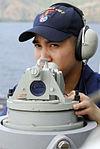 Sailor gets bearings for Essex helm DVIDS94083.jpg