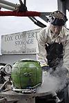 Sailor refills liquid oxygen tank aboard USS Nimitz DVIDS91188.jpg