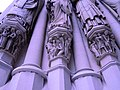 Saint John the Divine Cathedral (figures carved into columns, exterior, detail).jpg