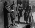Salvation Army lassies giving sweets to returned (African American) soldiers. Two soldiers of the 3 . . . - NARA - 533625.tif