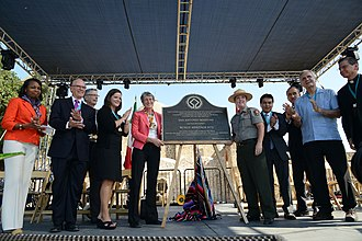 Deputy Assistant Secretary for Fish and Wildlife and Parks Michael Bean (third from left), at the 2015 dedication of San Antonio Missions UNESCO World Heritage Site San Antonio Missions WHS dedication ceremony (22234797786).jpg