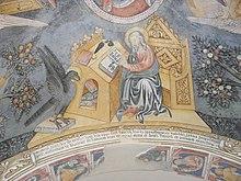 San Giovanni Evangelista (volta dell'atrio della Chiesa parrocchiale). Al di sotto l'iscrizione che data gli affreschi, voluti dal prevosto Bonsignore di Arborio, al 15 giugno 1444.