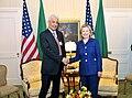 Secretary Clinton shakes hands with Libyan Foreign Minister Kousa.jpg
