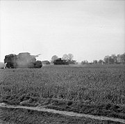 Sexton 25-pdr self-propelled guns of 86th Field Regiment firing against enemy positions in April 1945