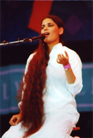 Sheila Chandra - Sheila Chandra live seated singing.