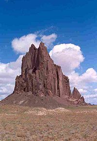 Shiprock, the erosional remnant of the throat of an extinct volcano.