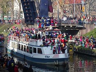 Sinterklaas - Sinterklaas and his Zwarte Piet helpers arriving by steamboat from Spain