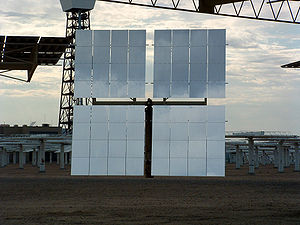 The Solar Project - One of Solar Two's heliostats is shown in 2003 with the solar power tower in the background