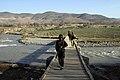 Soldiers cross a foot bridge in the Mirabad Valley.jpg
