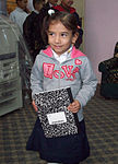 Soldiers distribute new school supplies to Sadr City children DVIDS151129.jpg