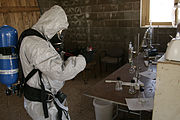 Soldiers from the 10th Special Forces Group (Airborne) Chemical Recon Detachment take pictures of a contaminated site during a training exercise here Feb 28 2008
