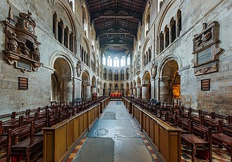 St Bartholomew-the-Great - Interior facing east: sanctuary in centre with Sir Robert Chamberlayne's monument (1615) on the left wall, opposite a memorial tablet to Alderman Percival and Agnes Smallpace
