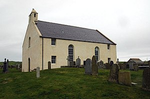 Sandwick, Orkney -  St Peter's Kirk, Sandwick. The sea is visible in the background.