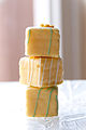 Stacked yellow Easter petits fours with stripes.jpg