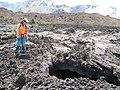 Starr-110810-7913-Pellaea ternifolia-habitat and lava tube with opening Kim view Red Flow beyond-Halalii Flow HNP-Maui (24984807242).jpg