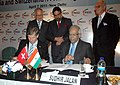 Sudhir Jalan and the President, Economiesuisse, Swiss Business Federation, Mr. Gerold Buhrer signing an MoU between FICCI and Economiesuisse, in the presence of the Union Minister for Commerce and Industry.jpg