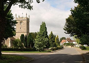 Sunningwell Road with the tower of St Leonard's parish church