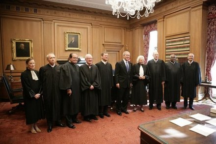 Justices of the Supreme Court with President George W. Bush (center), October 2005. Supreme Court October 2005.jpg