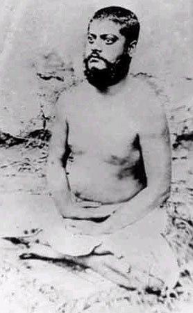 Image of Vivekananda, sitting in meditative posture, eyes opened