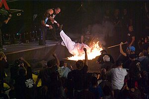 Team 3D forcing Abyss through a flaming table at Bound for Glory IV
