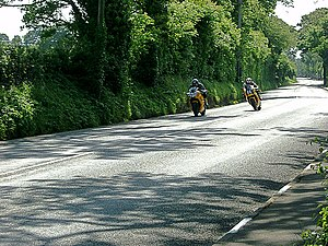 Quarry Bends - TT racers approaching Quarry Bends in 2003