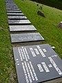 Tablice na symbolicznym cmentarzu w Łambinowicach.jpg